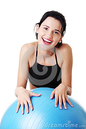 Young woman with pilates exercise ball.