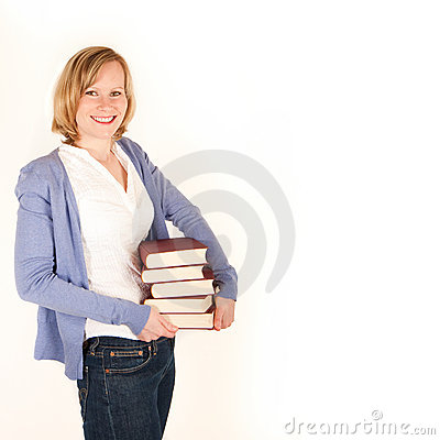 Young woman with a pile of books