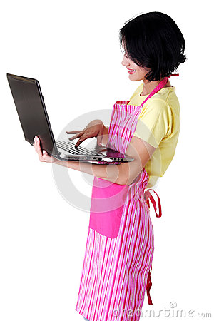 Young woman in pink appron using laptop