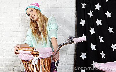 Young woman with pink  bike