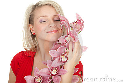 Young woman with pink orchid