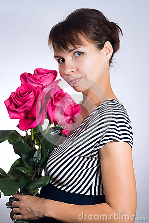 Young woman with pink roses