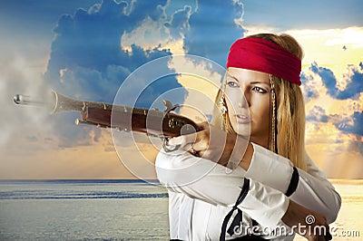 Young woman pirat shooting