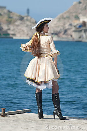 Young woman in pirate costume outdoors