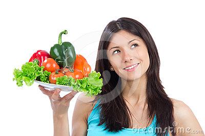Young woman with plate of fresh healthy vegetables