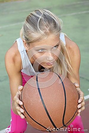 Young woman playing basketball