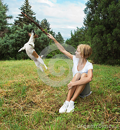 Young woman playing with dog