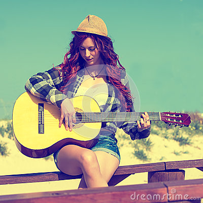 Free Young Woman Playing Guitar Stock Photos - 56504313