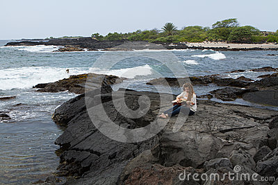Young Woman Playing Guitar by the ocean in Hawaii