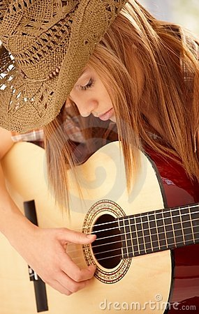 Free Young Woman Playing Guitar With Expression Stock Photos - 18718933