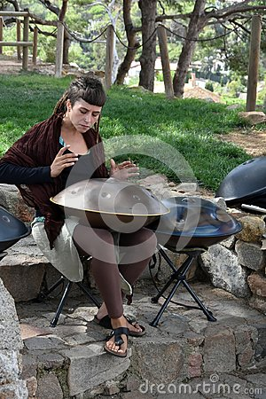 Free Young Woman Playing Hang Instrument Royalty Free Stock Photo - 108507275