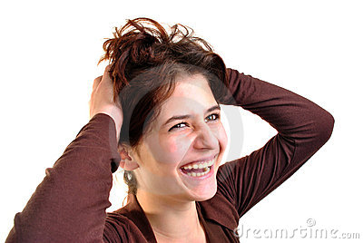 young woman is playing with her long hair