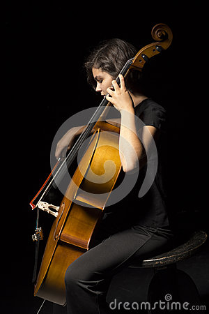 Young woman plays cello
