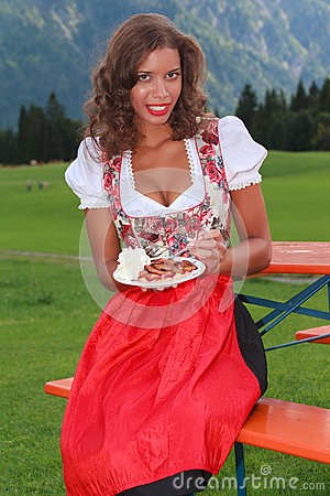 Young woman with plum cake and cream