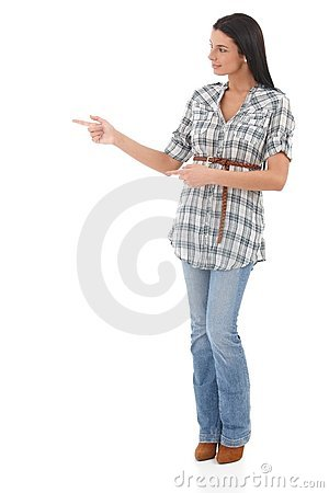 Young woman pointing and looking to the right Stock Photo