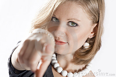 Young woman is pointing at you