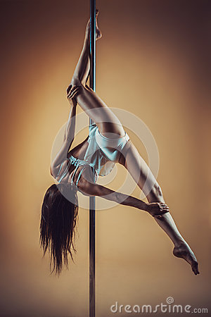 Free Young Woman Pole Dancing Royalty Free Stock Image - 96641056