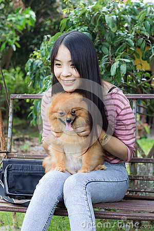 Young woman and pomeranian, portrait