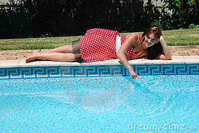 Young woman at poolside