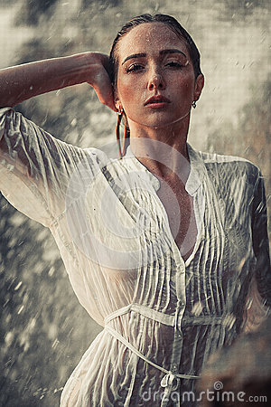 Free Young Woman Portrait In White Wet Shirt Near Waterfall. Stock Images - 92583084