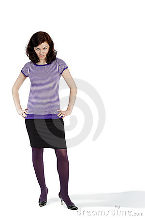 Young woman poses with her hands on hips Stock Photo