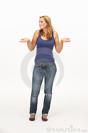 Young woman poses with shrugged shoulders