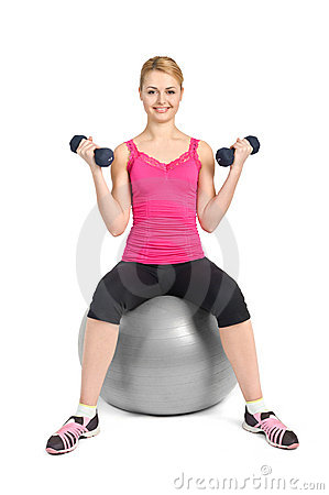 Young woman posing with dumbbells