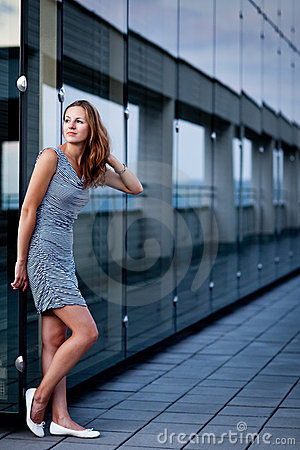 Free Young Woman Posing Inside A Modern Building Stock Photo - 22354020