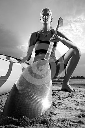 Young woman posing with kayak paddle