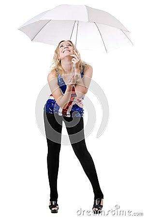 Young woman posing under umbrella