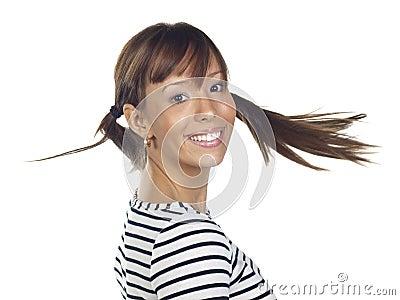 Young woman posing wearing a striped shirt