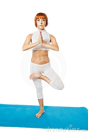 Young woman practicing yoga asana