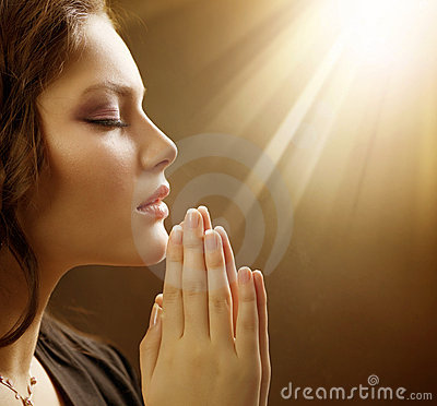 Young Woman Praying Close-up