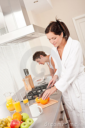 Young woman preparing breakfast in the kitchen