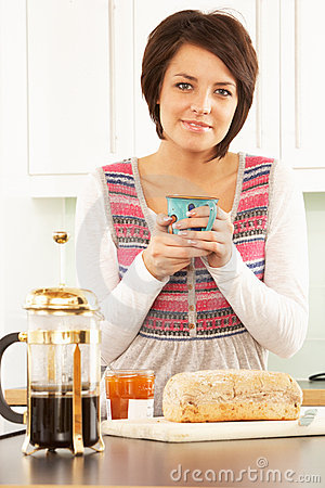 Young Woman Preparing Breakfast In Kitchen