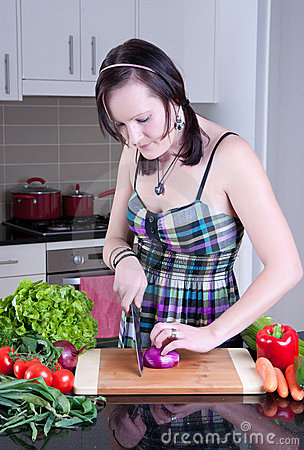 Young woman preparing healthy vegetables
