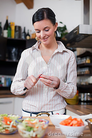 Young woman preparing lunch