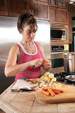 Young Woman Preparing Soup