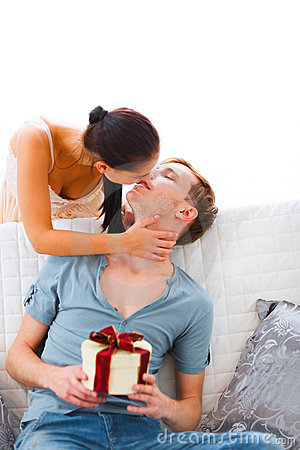 Young woman present gift to her husband