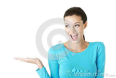 Young woman presenting copy space on her palm