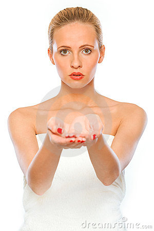 Young woman presenting something on empty hands
