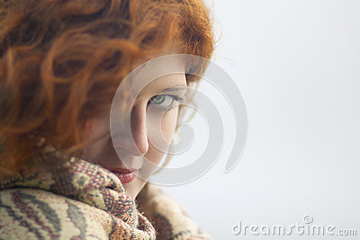Young woman protects her from the cold