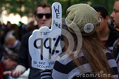 Young woman with protest sign at Occupy Wall Street Editorial Stock Image