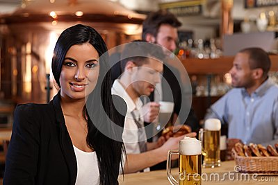 Young woman in pub