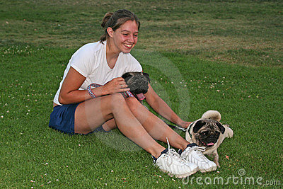 Young woman and pug dogs