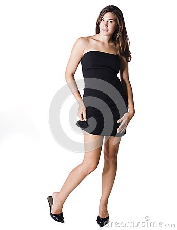 Young woman pulling up the hem of her dress