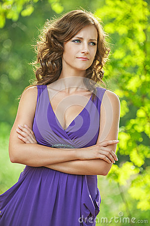 Young woman in purple dress thought