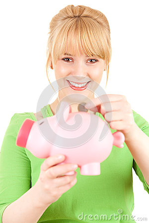 Young woman putting euro coin into piggy bank