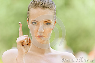 Young woman raises his index finger