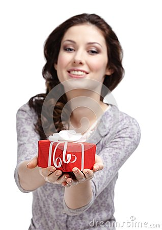Young woman reaches out a present